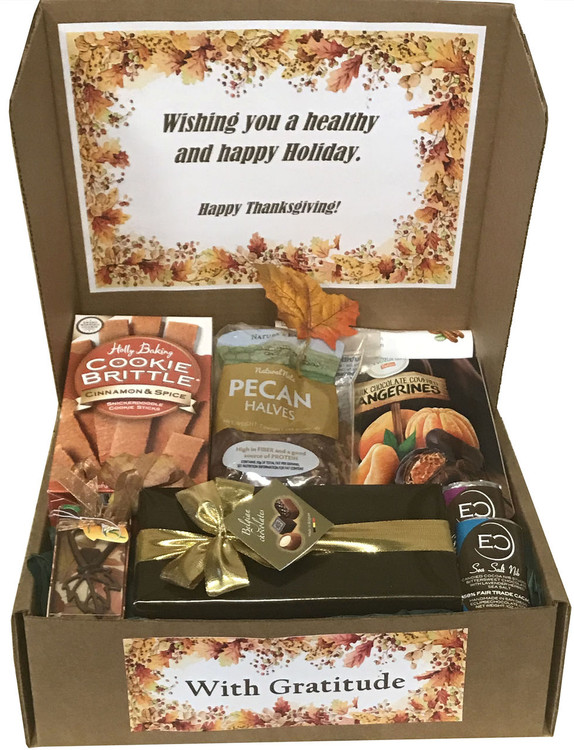 A beautifully presented, delicious surprise and nice greeting when they open their  gift box! Includes Cinnamon Spice Cookies (Gold Medal Winner), A gift wrapped box of Belgian Chocolates, all natural Pecans, Dark Chocolate Covered Tangerines, two Eclipse Chocolate Bars, and a copper Fall Leaf Bottle Opener. Great Fall and Thanksgiving gift.