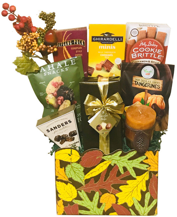 A striking, Fall themed gift box filled with scrumptious cookies, coffee, chocolates and nuts perfect for sharing with family or coworkers. Includes a gift wrapped box of Belgian Chocolates, Sea Salt Caramels, Dark Chocolate Covered Tangerines, Ghirardelli Chocolate Caramels, European style coffee, Sahale Pistachio and Cranberry Mix, and Cinnamon Spice Cookie Brittle (gold medal winner).   The gift also includes a beautiful scented candle and decorative enhancement.