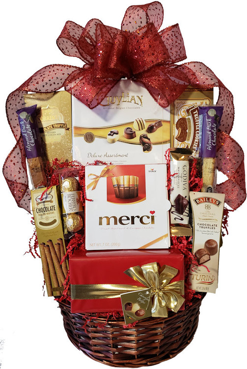 "This amazing basket will thrill any chocolate lover!  It includes assorted boxes  of fine European truffles, Belgian truffles, and assorted chocolates.  assorted cookies, and more.   This makes a great birthday, thank you or Valentine's Day gift for any serious chocoholic. It is also great for a Valentine's Day promotion to clients (for the whole office to share) with a free ribbon banner that reads ""We Love Your Business!  Items of equal or greater value may be substituted depending on availability and the discovery of great new seasonal items."