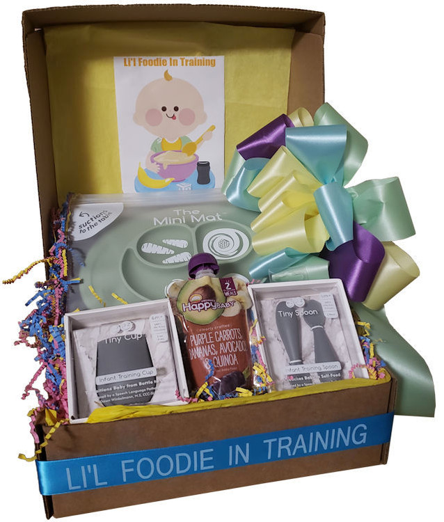 A very special, high end baby basket that includes a silicone divided baby plate and mat in one, silicone training spoons, and a silicone tiny training cup, along with a cute bib and organic baby food. The plate suctions to the table and fits most high chairs.