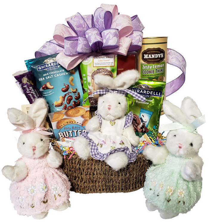 Features an adorable bunny dressed in an embroidered chenille dress. The basket is filled with a delicious assortment of chocolates, cookies & confections.   Goodies include: Ghirardelli chocolate covered cashews, Ghirardelli chocolate bunnies, Lemon Cookie Thins, rolled chocolate filled wafers, biscotti, French Butter Cookies, and cake mix that bakes in a cup (just add water and microwave)  The bunny's head, arms, and legs are jointed and movable. Bunny dresses vary  One bunny in each basket. Bunny dresses vary as shown The Sea Grass basket makes a great organizer after the goodies are gone. Great for Easter and Spring Boy bunnies are also available   Features an adorable bunny dressed in an embroidered chenille dress. The basket is filled with a delicious assortment of chocolates, cookies & confections.   Goodies include: Ghirardelli chocolate covered cashews, Ghirardelli chocolate bunnies, Lemon Cookie Thins, rolled chocolate filled wafers, biscotti, French Butter Cookies, and cake mix that bakes in a cup (just add water and microwave)  The bunny's head, arms, and legs are jointed and movable. Bunny dresses vary  One bunny in each basket. Bunny dresses vary as shown The Sea Grass basket makes a great organizer after the goodies are gone. Great for Easter and Spring Boy bunnies are also available