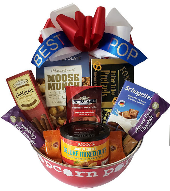 """A fun and functional metal popcorn bowl, that says """"More Popcorn Please!"""" when you get to the bottom, filled with a delicious assortment of popcorn, nuts, chocolates and snacks."""