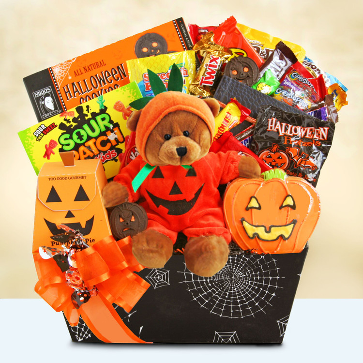 Our Halloween bear, surrounded by cookies and assorted candies,  is sure to deliver big smiles.