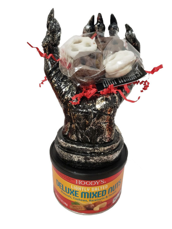 "A fun Halloween gift that is sure to deliver big smiles! We'll add a banner that says ""You Deserve A Hand!"" Includes a tin of Fancy Mixed Nuts, chocolates and the hand sculpture.  Note: This item is shipped ground from San Diego. To arrange  to pick up at our shop, please order by phone."