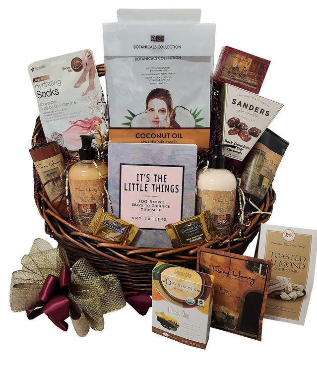 This luxurious spa basket includes high end Camille Beckman bath products along with a special book featuring 300 simple ways to indulge yourself! A great way to melt away the stress of the day! Includes:  Tuscan Honey Luxurious Body Cream in Pump Bottle Tuscan Honey Luxurious Bath Gel in Pump Bottle Tuscan Honey Hand Cream Tuscan Honey Body Powder Tuscan Honey Soap Tuscan Honey Drawer Sachet Chocolate Sea Salt Caramels Cookies Tea Assorted Pampering Products Items of equal or greater value may be substituted depending on availability
