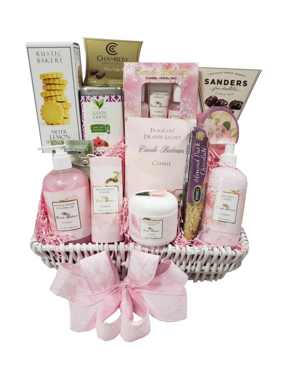 A gorgeous basket featuring high end Camille Beckman products in their #1 selling fragrance, Camille. Includes:  A Camille Travel Kit with perfect size items to take to the gym or on a getaway Camille Luxurious Body Lotion in Pump Bottle Camille Bath Gel in Pump Bottle Beautiful Tub of Camille Hand Cream with rose enhancement on top Camille Soap Camille Bath Powder Camille Drawer Sachet Delicious Chocolate Truffles Tea Chocolate Sea Salt Caramels Rustic Bakery Lemon Shortbread Cookies Items of equal or greater value may be substituted depending on availability.