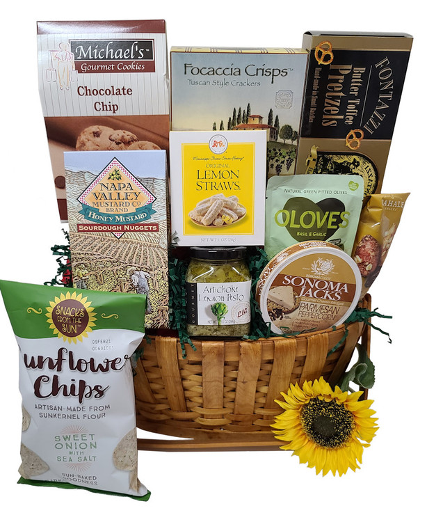 Great goodies to share with family for a picnic right at home, in the backyard, or at the park. Includes an assortment of sweet and savory things in a wooden, drop handle, basket.