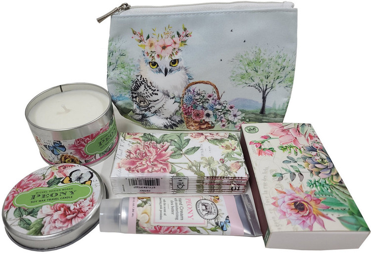 This pretty little gift includes a designer zippered bag, fragrance candle in tin, coordinated matches to light candle, floral pocket tissues, and upscale hand cream for purse.