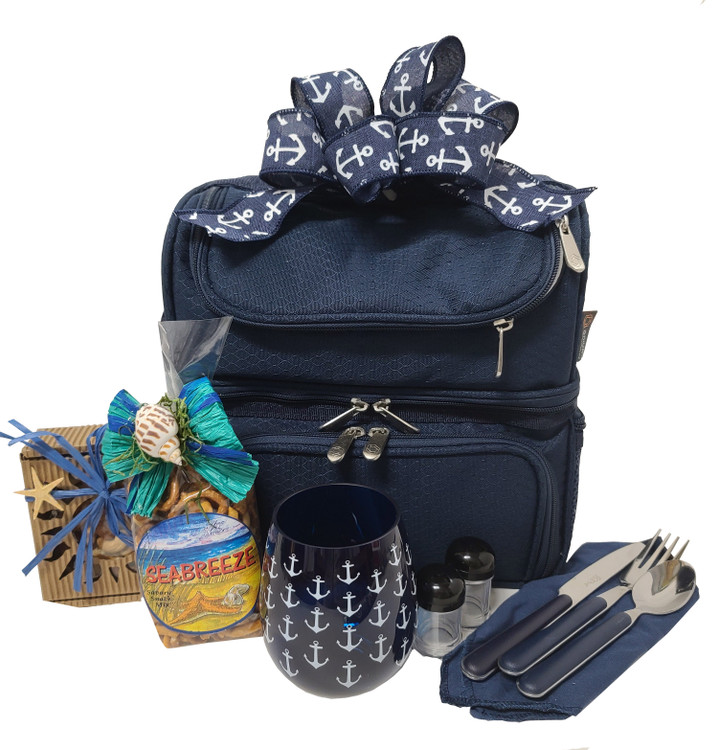 This fun and functional lunch/picnic bag has silverware, a nautical glass, salt and pepper shaker, three compartments (one insulated for hot or cold food) and side pockets. We have also added Sea Breeze Snack mix,  fancy mixed nuts, and topped it off with a nautical bow. It is great for packing a lunch, day at the beach, outdoor concerts, sporting events and picnic.