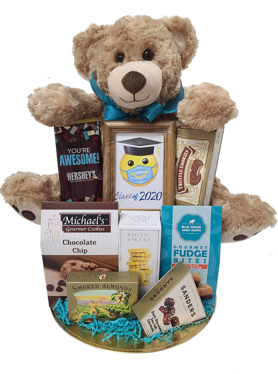 This adorable graduation 2020 design commemorates this memorable year with a large plush bear holding a plush frame with a smiley face wearing a mask and graduation hat. They can keep it that way as a conversation piece, or put their favorite picture in it. Also includes:  Your're Awesome Chocolate Bar Chocolate Truffle Cookies Chocolate Chip Cookies Rustic Bakery Shortbread Fudge Bites Smoked California Almonds Chocolate Sea Salt Caramels Gold Platter Items of equal or greater value may be substituted depending on availability and the discovery of great new products.