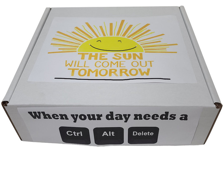 When someone you care about is having a bad day, you can turn their frown upside down with this humorous and uplifting box of sweet and savory comfort food! The gift will include cookies, chocolates, cheese, crackers, pretzels, nuts, shortbread, tea, honey, and more.
