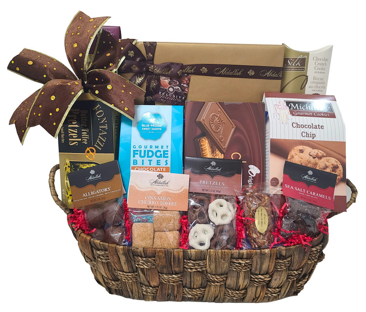 A handsome large container filled with the most decadent chocolates, cookies and desserts around! Includes an elegant box of assorted chocolates, chocolate pretzels, chocolate chip cookies, chocolate covered cookies, chocolate sea salt caramels, toffee pretzels, chocolate crunch cookie, fudge bites, cinnamon churro toffee, and chocolate alligators.   Items of equal or greater value may be substituted depending on availability and the discovery of great new products. Other desserts will be substituted  during warm weather.
