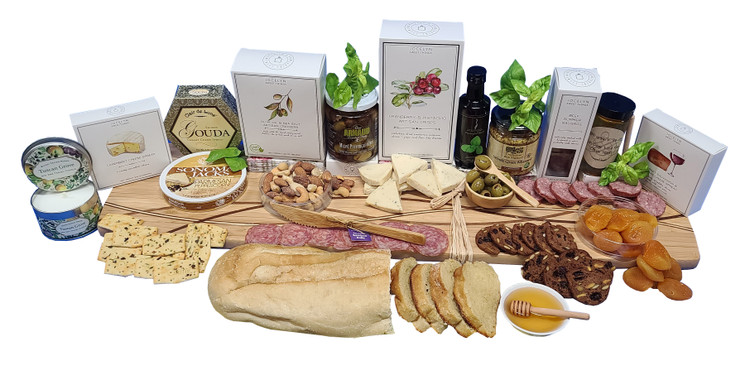 This gift is designed on a beautiful, 28 inch long, modern bamboo Charcuterie board with a beautiful design inlay throughout. It also includes a Charcuterie suggestions card.  It creates an  impromptu celebration! Just add a bottle of wine and share with family, friends or colleagues. Includes:  Parmesan Peppercorn Cheese Smoked Gouda Cheese Camembert Cheese Smoked Cheddar Cheese Summer Sausage knife Thin sliced salami Mustard Olives Mini bamboo spoon Olive bowl Cranberry Crisps Savory crackers Olive Oil Apricots Mixed Nuts A loaf of organic sourdough bread that bakes at home in minutes Honey Honey Dipper  A candle for added ambiance Items of equal or greater value may be substituted depending on availability and the discovery of great new products.