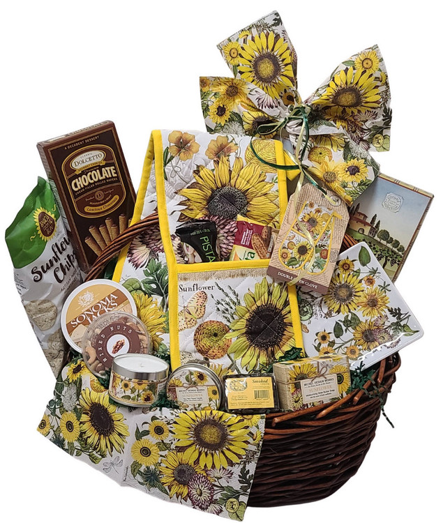 This gift is brimming with nice gifts for the home in a bright and beautiful sunflower design, and some gourmet goodies. Includes: A double oven mitt (can also be used as a decorative table runner) sunflower candle, triple milled soap from England, a sunflower dessert plate, mixed nuts, Sonoma Jack Cheese, crackers, Sunflower Chips, and chocolate filled pastry cookies.