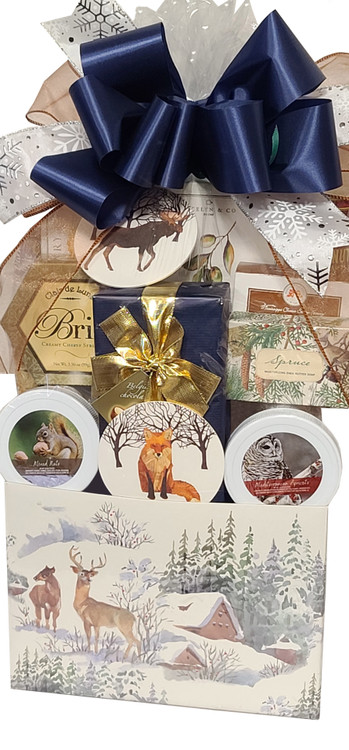 A beautiful and serene nature scene to escape to,  is created with our Winter Forest themed gift. Includes: Full color gift box with snowy forest, cabin and deer (makes a great organizer) A beautiful box of Belgian Chocolates, triple milled Spruce Soap from England, Fox and Moose coasters, Dried Apricots in Snow Owl container,  Mixed Nuts in Squirrel container, Meyer Lemon Shortbread, Brie Cheese, Crackers, and Hot Cocoa packets. Items of equal or greater value may be substituted depending on availability and the discovery of great new products.