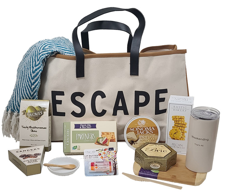When you need to get away from a noisy, hectic, stressful week, even if only for one night of peace, quiet, and cozy self time, this is the perfect gift! The large, designer canvas bag is filled with:  Brie Cheese Sonoma Jack Cheese Bamboo Knife Appetizer Crackers Olives Porcelain Olive Dish Bamboo Spoon A Cool Weekend Tumbler with Lid Chocolate Sea Salt Caramels Delicious Shortbread from Rustic Bakery Soft, Cozy, throw Luscious Lip Butter All packed in a large designer canvas tote with leatherette handles Items of equal or greater value may be substituted depending on availability and the discovery of great new items.