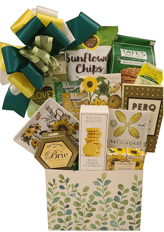 The lovely leaf gift box makes a great organizer after the goodies are enjoyed. This gift includes:  Triple milled Sunflower soap from England A melamine sunflower dessert plate Sunflower Napkins Sunflower Chips Shortbread Cookies Cheese Crackers Olives Marinated Artichokes Cookies Coffee Tea Items of equal or greater value may be substituted depending on availability and the discovery of great new products.