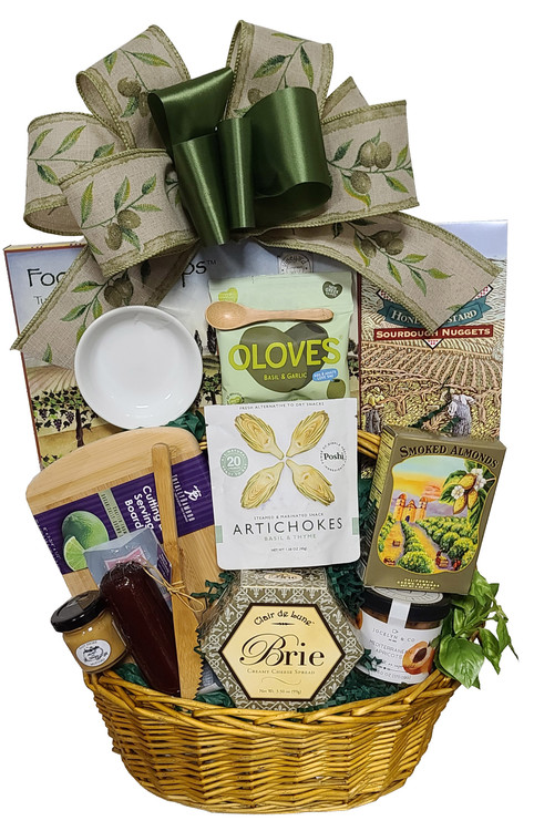 This Savory basket is filled with a nice assortment of Charcuterie items. It includes cheese, summer sausage, mustard, crackers, olives, artichokes, smoked almonds, honey mustard pretzels, dried apricots, and even a cutting board, porcelain olive dish, bamboo olive spoon, and bamboo knife.