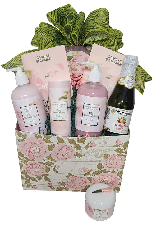 Designed in a pretty rose box, this gift features the luxurious and high end spa products from Camille Beckman, in their number one selling fragrance, Camille. The box makes a great organizer. Includes:  Pump Bottle Silky Body Cream Pump Bottle Body Gel Hand Cream in pretty tub topped with a rose Body Powder Fragrant Drawer Sachets Mini Sparkling Cider Items of equal or greater value will be substituted depending on availability.