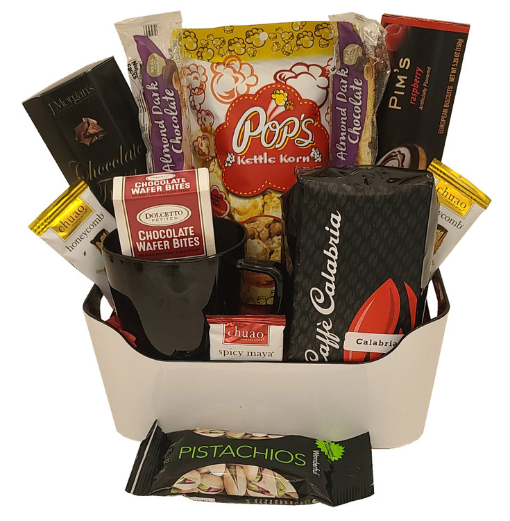A modern organizer tray filled with high end coffee, coffee mug, desserts and snacks.