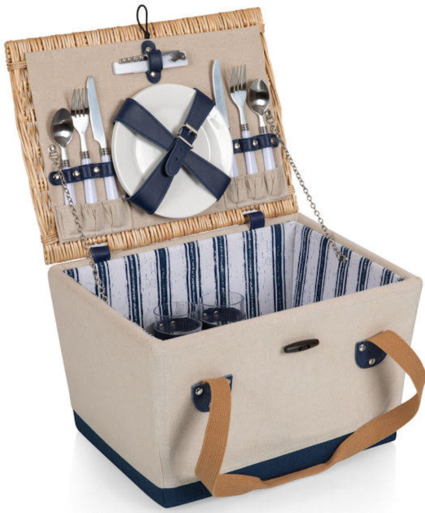 A Stylish Picnic Basket that includes complete service for two. Includes plates, silverware, bottle opener, and two wine glasses.  This gift is great for the beach, picnics, boating, and more.  Note: If you would like to have it upgraded with charcuterie items, like cheese, crackers , nuts, olives, dips, cutting board and more, give us a call.