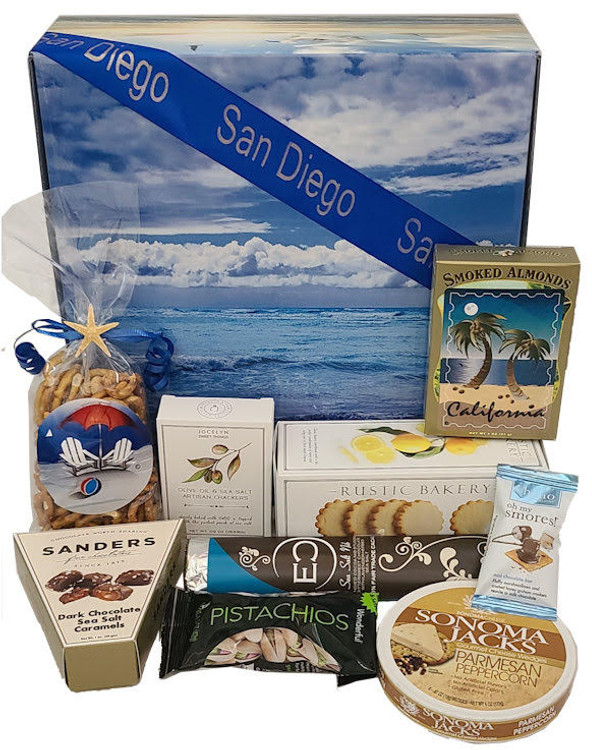 A gorgeous ocean themed gift box with ocean waves and seagulls flying on the sides of the box, filled with a sweet and savory assortment. The gift includes:  A beautiful, laminated, ocean themed box. It has ocean waves on top and sea gulls flying on the sides. (A soothing image to meditate on, and transport yourself to the ocean!) California almonds Beach theme snack mix Olive oil and sea salt crackers Shortbread Eclipse chocolate (rich, upscale, and delicious) from a local chocolatier. Sonoma Jack's Parmesan Peppercorn cheese Chocolate sea salt caramels California Pistachios Items of equal or greater value may be substituted depending on availability and the discovery of great new products.