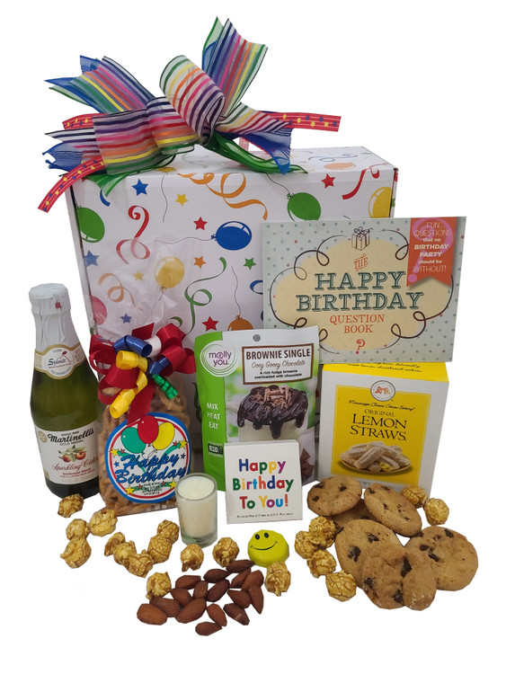 We fill this festive birthday box with yummy snacks and fun little gifts! It includes:  A delicious chocolate mug cake (just mix with water in a mug and it  bakes in the microwave in minutes) Almonds Mini Sparkling Cider small candle Birthday Matches Smiley Faced Chocolate Caramel Corn Lemon Straw Cookies Apricot Cookies Birthday Snack Mix Happy Birthday Questions Book (A fun conversation starter!) Chocolate Chip Cookies
