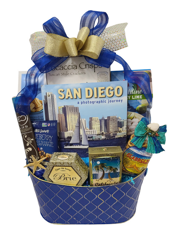 This beautiful royal blue and gold metal basket is new and very popular!  This striking presentation includes:  A beautiful, full color pictorial book of San Diego Sea Breeze Snack Mix California Almonds Brie Cheese Crackers Blueberry Snack Mix Key Lime Cookies Cookie Straws A Tall Gourmet Chocolate Bar from Eclipse Chocolate