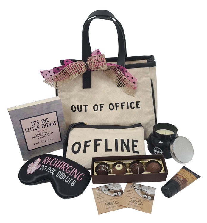 """This trendy gift is perfect for the work-a-holic  that deserves a break from the office, the computer, the phone, and everything except total relaxation!  The gift includes:  A Tote Bag that says """"Out Of Office"""" ( stylish, trendy, and a conversation starter) A Zippered Bag that says """"Offline"""" to put jewelry, cosmetics, toiletries, sunglasses, or travel essentials Book called """"It's The Little Things! 300 Ways to Indulge Yourself!"""" Four Piece Box of Fine Chocolate Truffles Soft """"Do Not Disturb, I'm Re-Charging!"""" Sleep Mask Scented Candle Tea"""