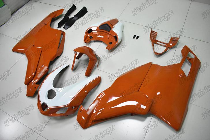 2005 2006 Ducati 749 999 orange and white fairing.
