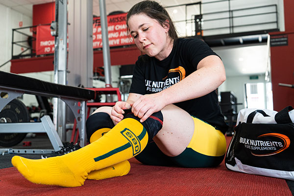 Powerlifters are required to wear specific gear in competition including a soft suit and long socks for the deadlift.