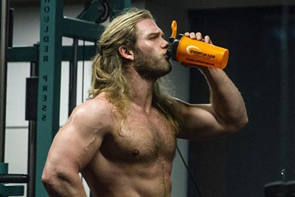 Andrew Lutomski Drinking a Muscle Gainer