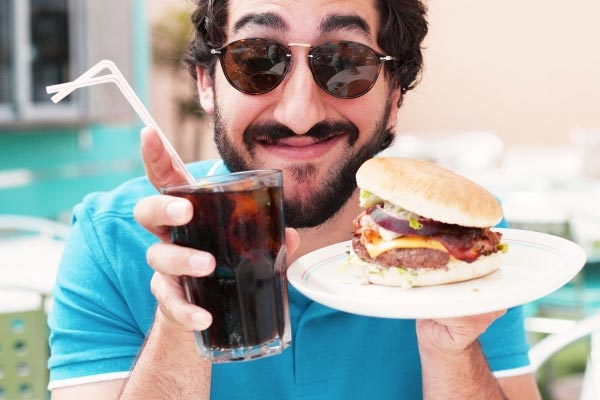 An easy way to cut out excess calories is by making smart choices such as still enjoying burger night with friends but opting for a Coke No Sugar over a milkshake.