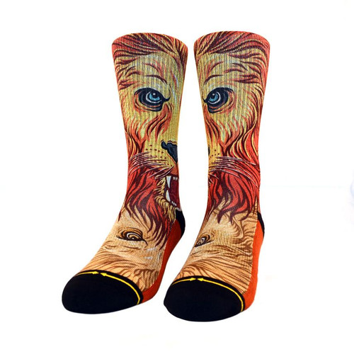 As the sun sets down across the plains Golden rays stroke my aging mane I know soon I may be driven away But the fight in my eye says it won't be today  Embrace your inner lion and rock these awesome socks with artwork from artist, Shaun Logan. Between October 1, 2019 and September 30, 2021, MERGE4 will donate 7% of the gross sales from each pair of these socks directly to the San Diego Zoo Global Wildlife Conservancy and their conservation efforts around the world – thank you for your support!