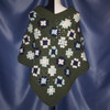 Granny Square Poncho in Dark Blue Pale Green and White surrounded by Dark Green.