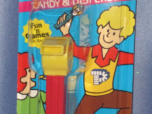"""Yellow Coach """"Whistle"""" Candy Dispenser by PEZ."""