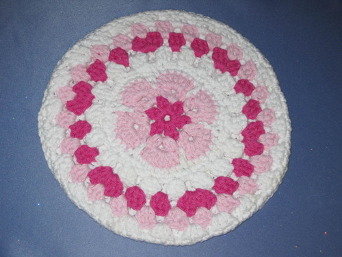 Round African Flower Potholder-Trivet in Pink and French Fuschia by Mumsie of Stratford.