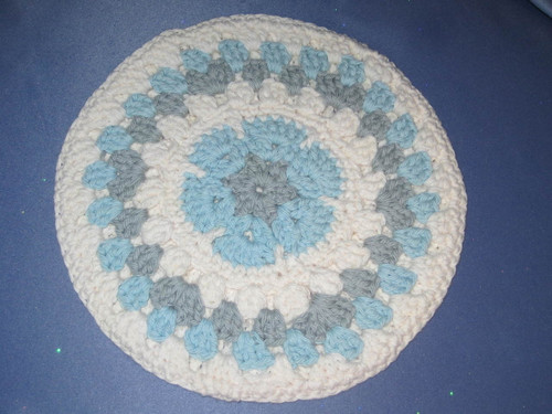 Round African Flower Potholder-Trivet in Light Blue and Grey by Mumsie of Stratford.