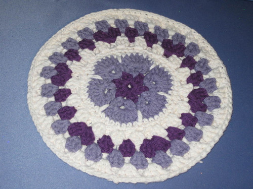 Round African Flower Potholder-Trivet in Lavender and Violet by Mumsie of Stratford.
