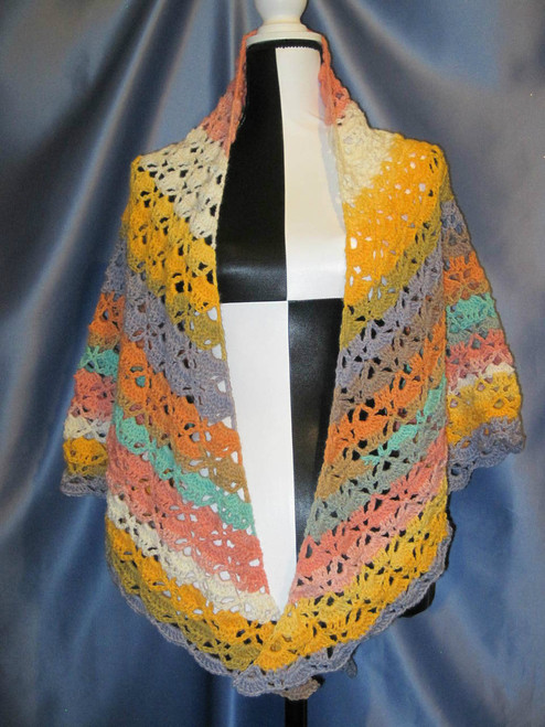 Cloister Shell Shawl in Multi-color Oranges by Mumsie of Stratford.