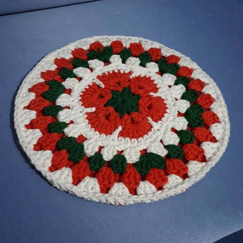 Round African Flower Potholder-Trivet in Red Green w/Red Back by Mumsie of Stratford.