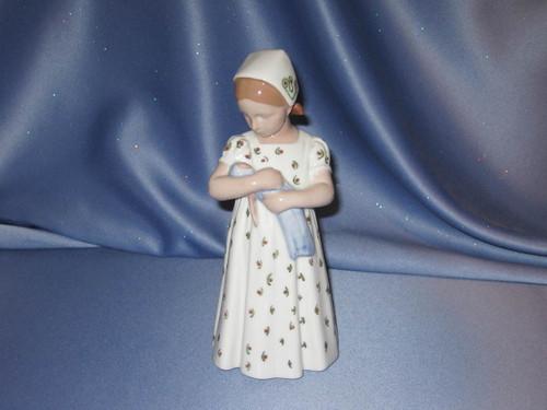 Girl Standing with a Baby Doll - Copenhagen - Bing & Grondahl.