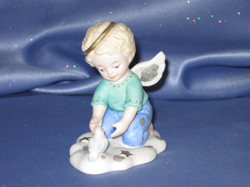 Tender Moment Angel Figurine by Bronson Collectibles.