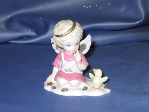 Listen to the Angels Angel Figurine by Bronson Collectibles.