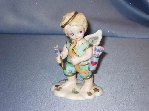 Love is in the Air Angel Figurine by Bronson Collectibles.