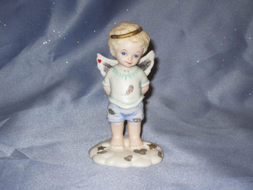 Guess Which Hand? Angel Figurine by Bronson Collectibles.