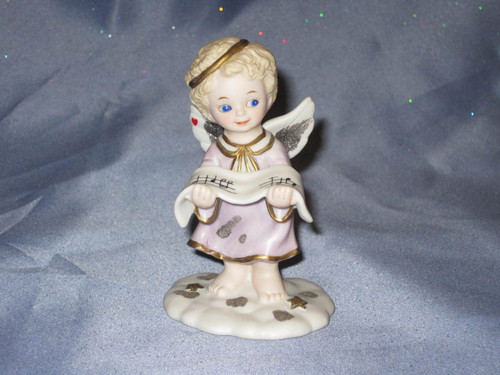 Hymns Of The Heavens Angel Figurine by Bronson Collectibles.