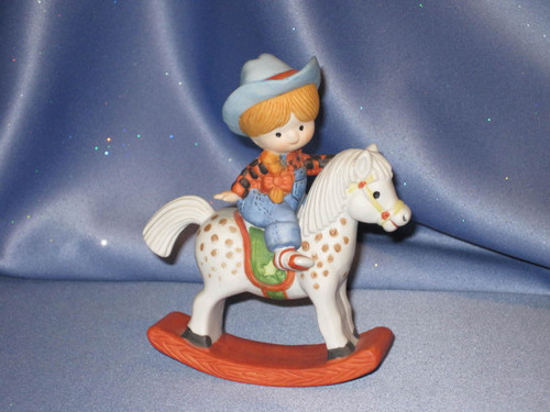 Red Headed Girl on a Rocking Horse by Enesco.