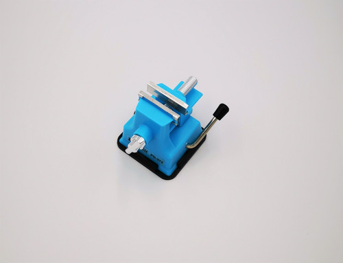 Plastic Vacuum Mini Vise used for repairs to small items. Simply place on your table and desk and pull the lever to firmly attach the vise.