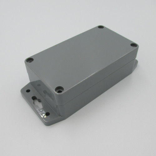 Grey Enclosure 115L-65W-40H With Flange, made of ABS (acrylonitrile butadiene styrene).